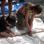 Kids making teepee